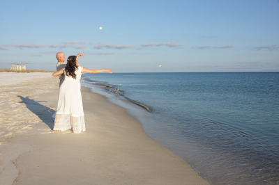 Seashell Toss after their Perdido Key Beach Wedding!