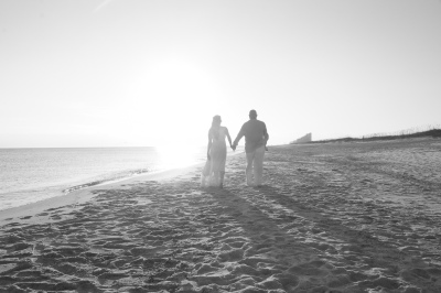 Walking into a Beautiful Sunset after their Simple Beach Wedding at Perdido Key, FL