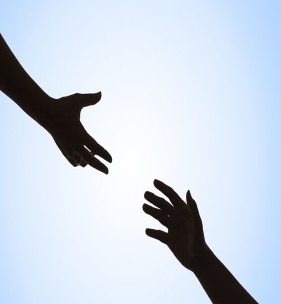 Two hands reaching out to each other.