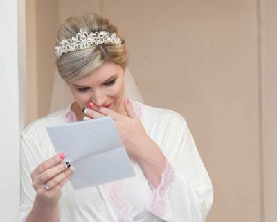 bride reading letter from groom tears the note