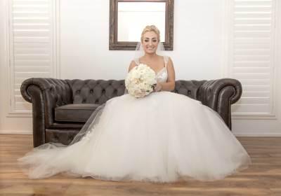 bride on couch wedding dress bride getting ready