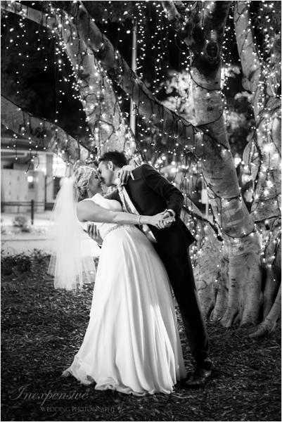 bride and groom kiss wedding photographers brisbane inexpensiveweddingphotography noosa wedding