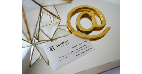 mimi pineau business card and décor items