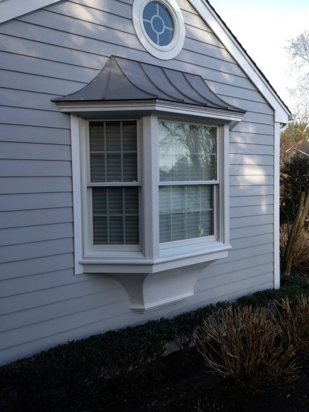 Unique bottom finish to Andersen Bay window, PVc curved bottom fabricated in shop