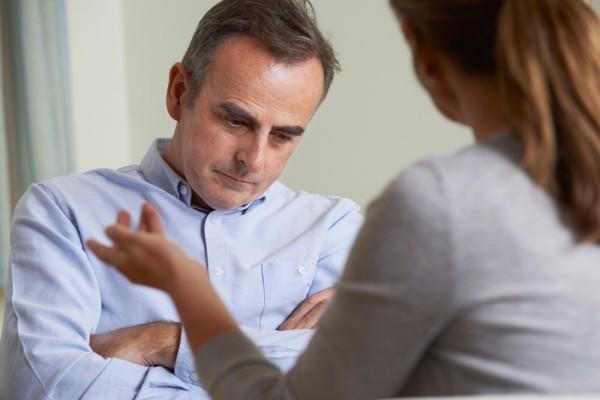 depressed man talking to counsellor