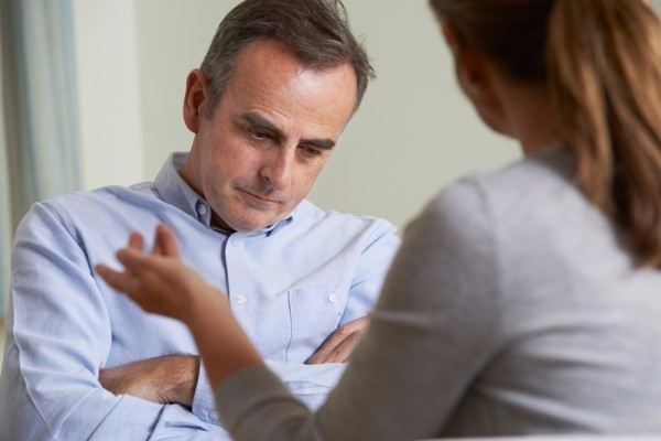 depressed man talking to counsellor