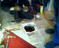 accessing slab leak through floor