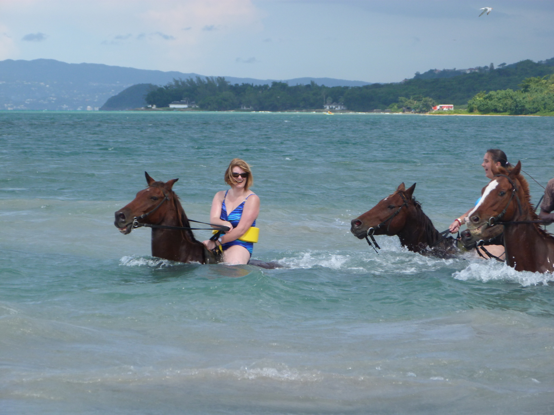 Melina horse riding at the beach