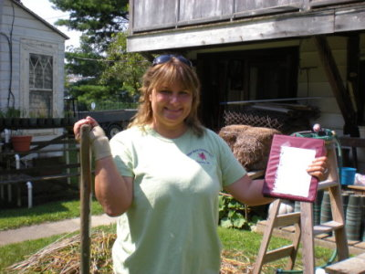 Heather with Peter's shovel and daylily bible