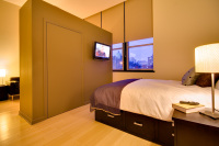 Furnished studio bedroom with flat panel TV