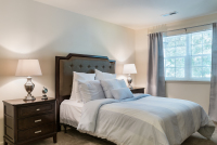 Extended stay furnished apartment master bedroom with hotel quality linens and towels in Williamsport PA