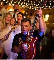A bride dances with the Narrow Gauge Band at her Colorado wedding