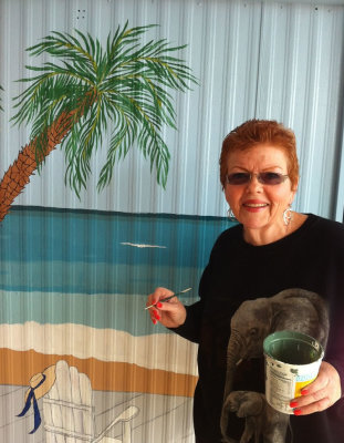 Dana painting beach mural