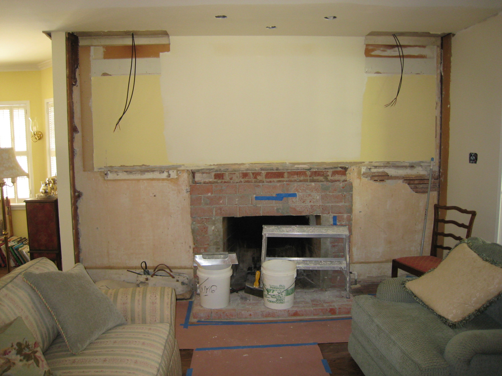 Cottage Hearth Before Book Cases