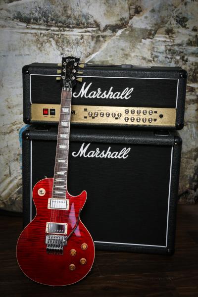 Guitar leaned against Marshall amplifier
