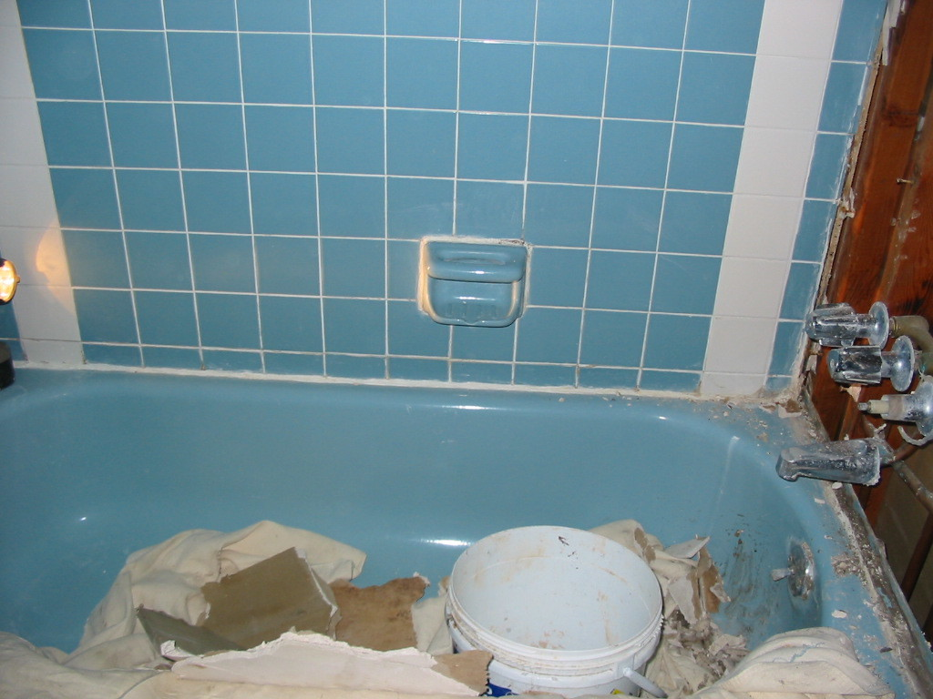 Damaged tiles and leaky faucet
