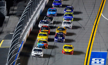 Joey Logano (Red and Yellow Ford) races in a pack at Daytona  (Team Penske Photo)