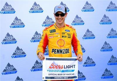 Joey Logano celebrates his Pole Award.  (NASCAR Photo)