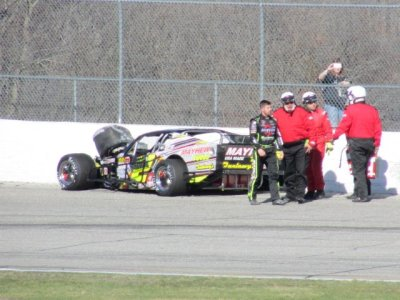 Doug Coby walks away from his mangled racecar at Thompson.  (MIke Twist Photo)