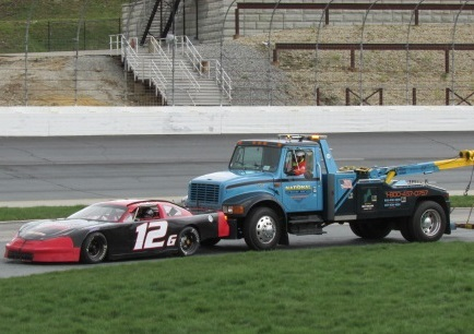 Derek Griffith's #12G gets pushes in after an engine issue.  (Mike Twist Photo)