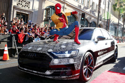 Spider Man hops on a disguised Audi A8.  (Audi Photo)