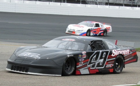 Matt Swanson (#49) and Travis Fisher (#8) at NHMS.  (Mike Twist Photo)