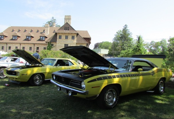 A Camaro and a Cuda draw fans on The Lawn.  (Mike Twist Photo)