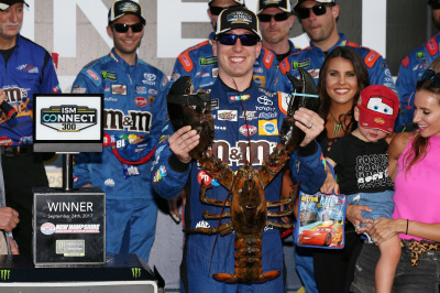 Kyle Busch, and a new friend, in victory lane at New Hampshire Motor Speedway.  (NHMS Photo)