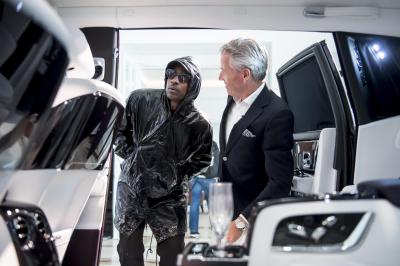Skepta looks over the interior of a Rolls-Royce.  (Rolls-Royce Photo)
