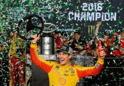 Joey Logano celebrates his championship.  (NASCAR Photo)