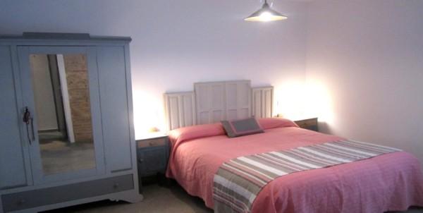 Dormitorio en planta baja con vistas al patio