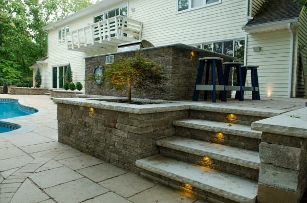 Landscape Contractors Near Me. Master Plans, Residential / Commercial Landscape Design / Build. Discuss / Develope / Design / Build Solutions. Custom Planting Designs. Garden Spaces. Paver & Stone Patios, Walkways, Driveways, Landings, Steps, Terraces, Walls, & Floors. Paver Installers Of EP Henry, Techo-Bloc, & CST. Sherwood Custom Hardscaping. Outdoor Patio Rooms & Garden Surrounds. Paver Block Seating Walls & Blue Stone Capping Units. Blue Stone & Slate Floors. Raised Patios & Terraced Patios. Brick Patios, Walkways, Driveways, Landings  Terrace Floors. Kitchens, Outdoor Kitchens & Outdoor Built In Kitchens. Barbeques, Custom Outdoor Paver Barbeques, & Appliances. Paver Wall Block Fire Pits, Stone Fire Pits, Boulder Fire Pits, Custom Fire Pits. Block Walls, Boulder Walls, Stone Walls, Rail Road Tie Walls & Veneer Walls. Columns, Brick Columns, Paver Block Columns, Light Columns & Stone Columns. Out Door Fireplaces, Brick Fireplaces, Paver Block Fire Places, Natural Stone Fireplaces, & Veneer Stone Fireplaces. Property Site Enhancements & Debris & Leaf Clean-ups. Spring & Fall Property Clean-Ups. Spring & Fall Mulch Installation. Spring Shrub Bed Definition. Planting Bed Revitalization & Mulch Installation. Plant, Shrub, & Tree Health Care Programs. Residental Property Seasonal Floral Displays. Plant & Tree Design & Installation. New Shrub Bed Design. Tree & Shrub Privacy Hedge Installation. Nightscaping Low Voltage Lighting System Desig & Installation. Outdoor Lighting Design, Low Voltage Lighting Installation, LED Lighting Fixture Installation, Low Voltage Lighting Installation For Property Security, Lighting For Property Enhancements, Paver Lighting, Step Lighting, Column Lighting, Tree Lighting, Shrub Bed Lighting, Wall Lighting, Paver Floor Lighting, Walkway Lighting, Patio Lighting, House Lighting, Pool Lighting, Water Feature Lighting, Pond & Waterfall Lighting, Up-Lghting, Down-Lighting, Moon Lighting & Pathway Lighting. Arbor & Pergola Design & Installati
