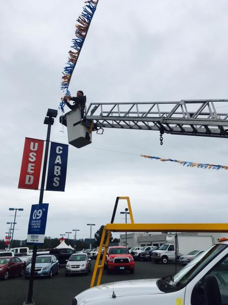 Hanging Streamers for Brian McLean Used Car Section
