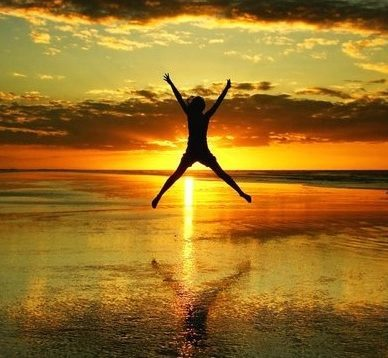 "alt=""Empowerment - Jumping in Sunset"""