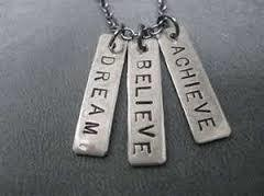 "alt=""Necklace with Dreams Believe and Achieve pendants on it"""