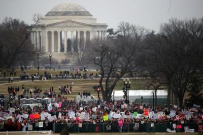 "alt=""Woman's March protesting Trump"""
