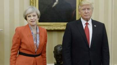 "alt=""May & Trump meet in USA"""