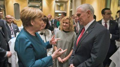"alt=""Merkel & Pence"""