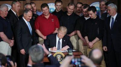 """alt=""""Trump signing EO"""""""
