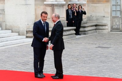 "alt=""Macron hosts Putin in Paris"""