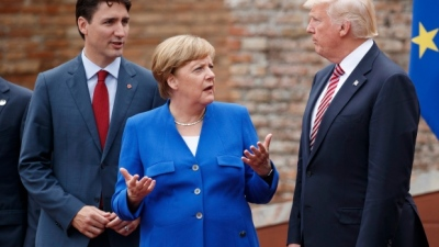 "alt=""Trudeau addresses Merkel-Trump rift, Canada committed to Europe & US"""