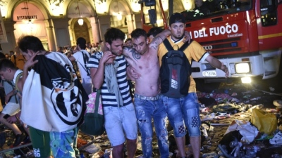 "alt=""More than 1,000 soccer fans injured in stampede in Turin, Italy"""