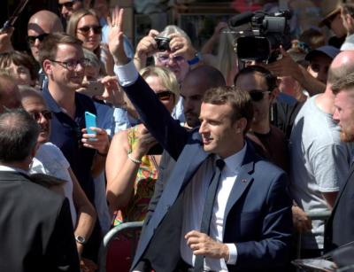 "alt=""French elect parliament as polls forecast Macron landslide"""