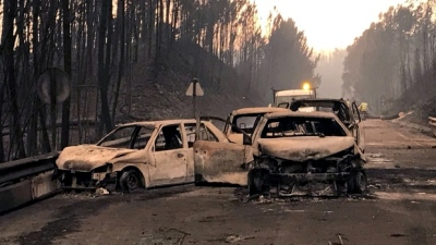 "alt=""Deadly forest fires devastate central Portugal, leaving more than 60 dead"""