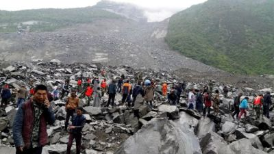 "alt=""100 people missing after a landslide in China's Sichuan province"""