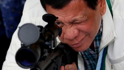 "alt=""Duterte's 1st year: A popular president in a bloody Philippine drug war"""
