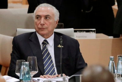 "alt=""A president facing a bribery charge now has effective control over corruption investigations in Brazil"""