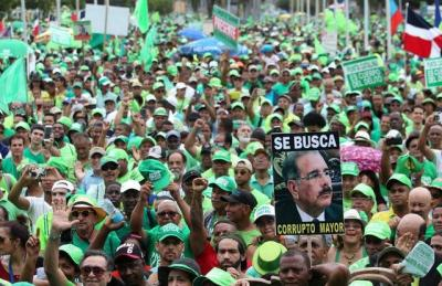 "alt=""Tens of thousands march over corruption in Dominican Republic"""