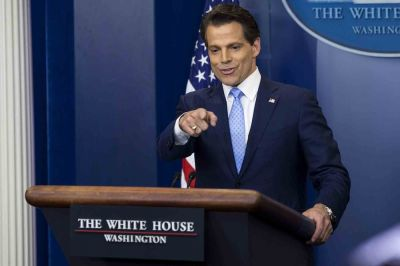 "alt=""'The Mooch' charms in White House debut, but challenges await"""