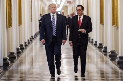 "alt=""Mnuchin Defends Decision to Stay as Trump Sees Healing Ahead"""